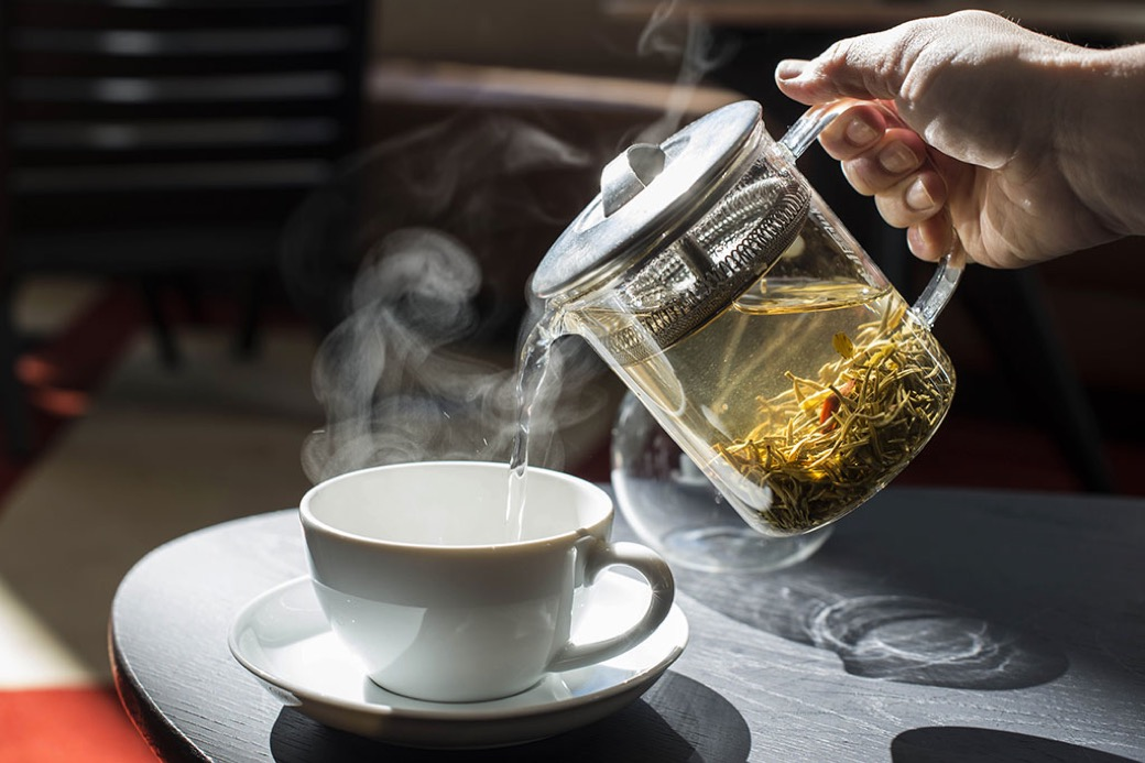 Pouring hot tea into glass at the Durham Hotel Coffee Shop