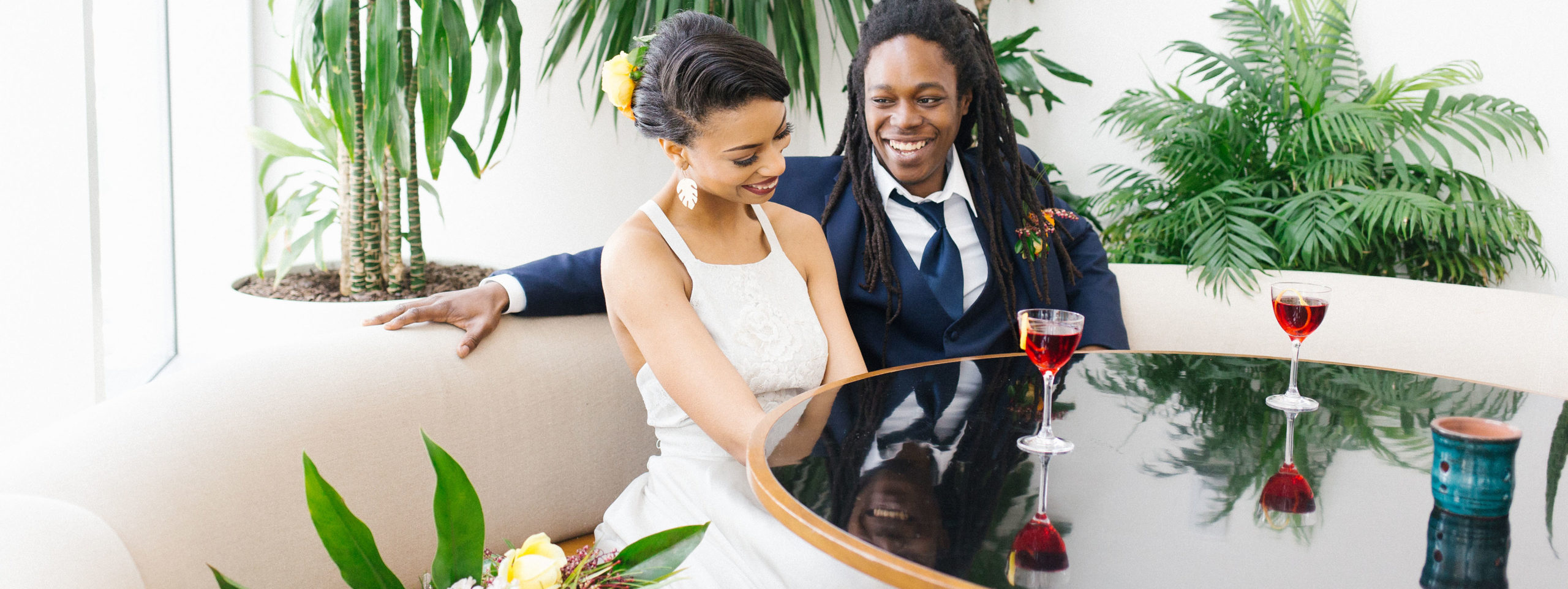 Bride and Groom at The Durham Restaurant with drinks in front of them smiling